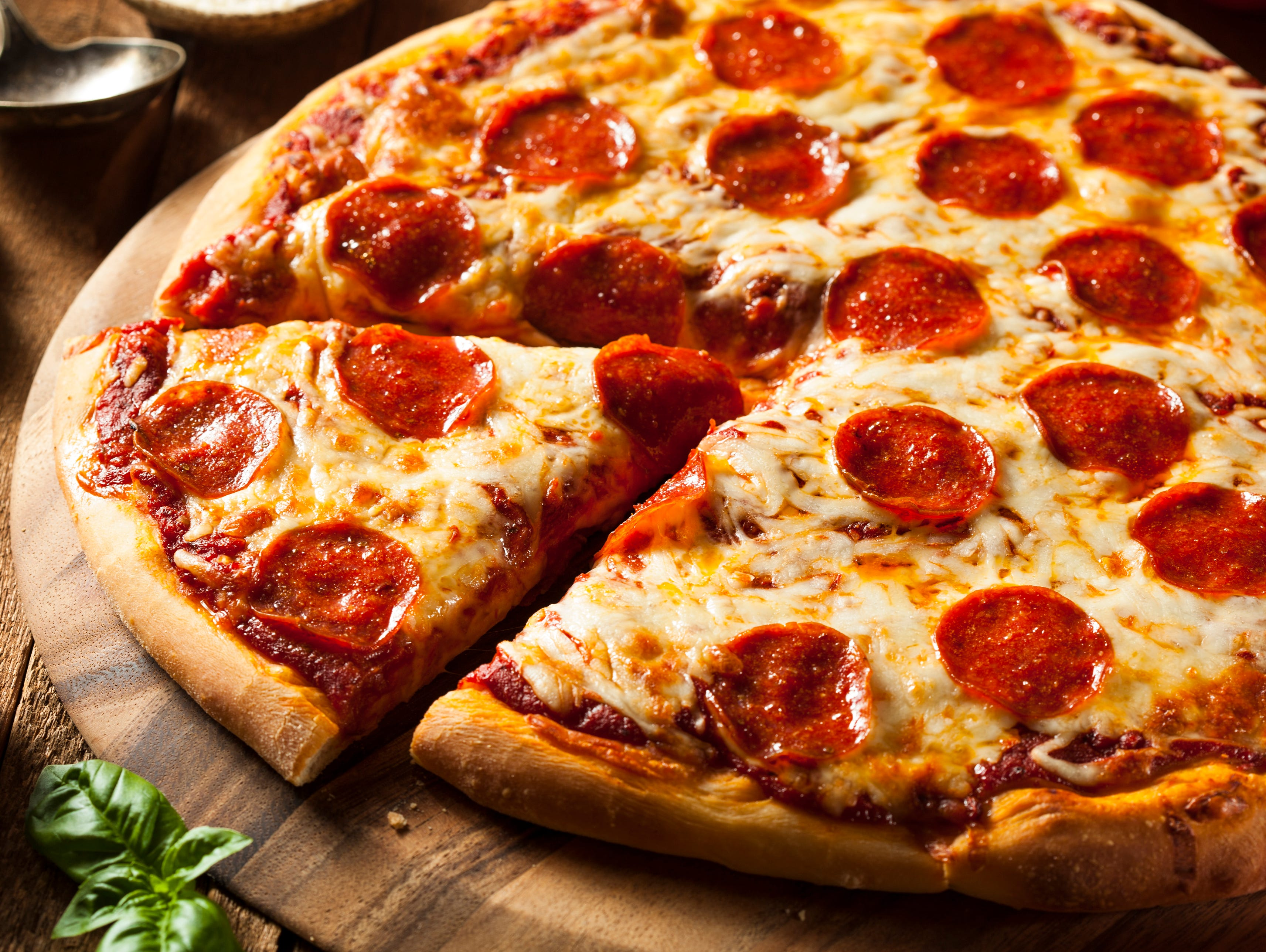 Buy any large pizza at the regular price and get a second pizza of equal or lesser value FREE.