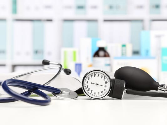 doctor desk with medical equipment, stethoscope and clinic tonometer, blood pressure measurement, drugs in background
