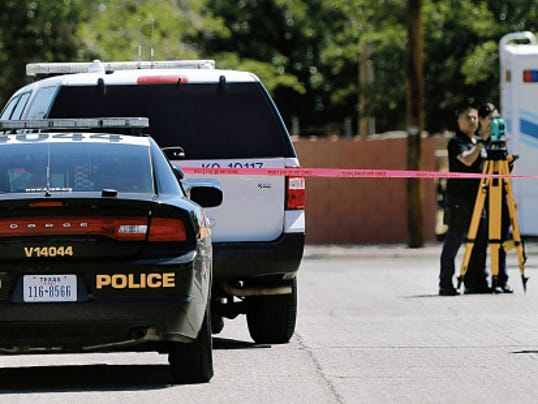 El Paso Police Department crime investigators Thursday collect information at the scene of the fatal shooting of a 22-year-old Mexican man, Erick Emmanuel Sanchez, by a police officer responding to a burglary report Wednesday in the Lower Valley.