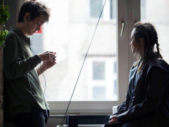 "Ryan Masson and  Alyona Konstantinova take a break during filming of ""Involution."" ."