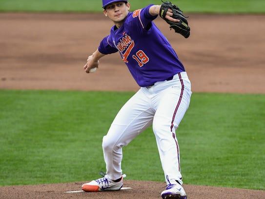 Clemson junior pitcher Brooks Crawford (19) pitches