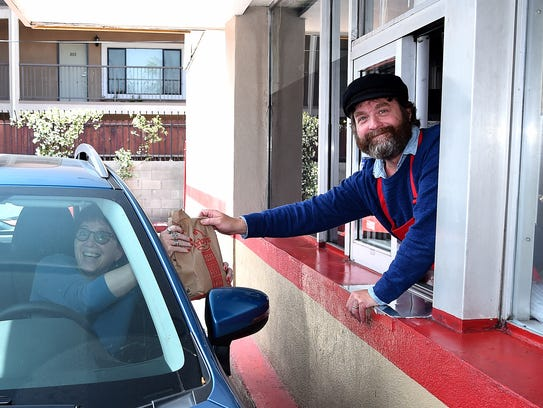 """Baskets"" star Zach Galifianakis, right, works the"