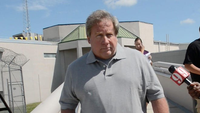 Former Brevard Clerk of Courts Mitch Needelman walks out of the Brevard County jail in 2013 after being arrested.