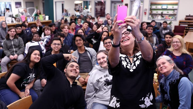 """Corpus Christi native and author Diana Lopez takes a selfie with students at King High School on Friday, Jan. 12, 2018. The author of """"Coco: A Story About Music, Shoes, and Family,"""" Lopez announced the planned publication of a second book set in Corpus Christi. The book,  """"Lucky Luna,"""" is set to be released in August."""