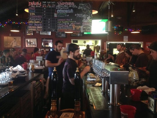 Bartenders serve customers at the Lagunitas Brewing Company's taproom in Petaluma, California.