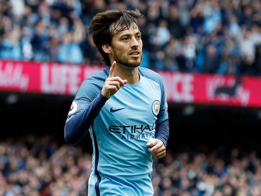 Manchester City's David Silva celebrates scoring his side's first goal of the game, during the English Premier League soccer match between Manchester City and Leicester, at the Etihad Stadium, in Manchester, England, Saturday May 13, 2017. (Martin Rickett/PA via AP)