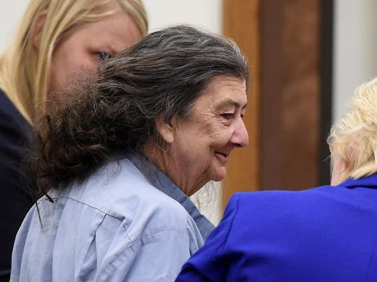 Cathy Woods, center, who had been imprisoned of more than 30 years, smiles with her lawyers while in a Wahoe district court in Reno, Nev. on Sept. 8, 2014 where she was granted a new trial based on recently evaluated DNA avidence in the 1976 murder.