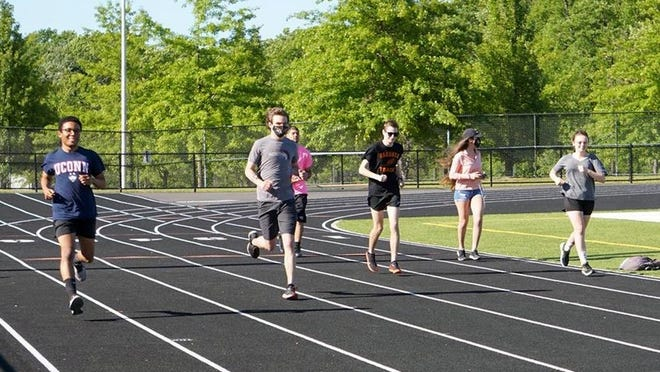 Seniors on the Gardner High boys' and girls' outdoor track and field teams take a final, collective lap around the Watkins Field track on Thursday, June 18, 2020. Pictured from left to right are Alex Lopez, Nick Smothers, Javian Colon, Hunter Graves, Janet Herrera and Monique Merillat. [Photo courtesy of Candee Graves]