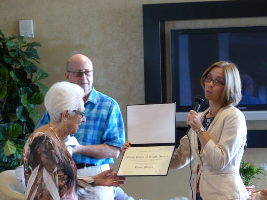 "Lorie Mayer (left) accepts an award honoring her as a ""Daily Point of Light."" Amy Snyder, the local Holocaust museum's  executive director (right), spoke about Mayer's accomplishments during a ceremony at Baypointe at Naples Cay on Oct. 19, 2016."