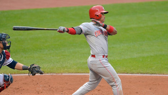Cincinnati Reds third baseman Ramon Santiago (7) hits a three-run home run in the second inning against the Cleveland Indians at Progressive Field.