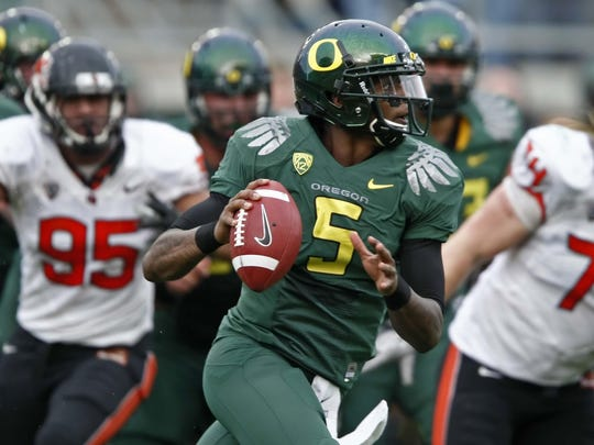 Oregon quarterback Darron Thomas looks down field to pass against the Oregon State defense in the second quarter during the 115th Civil War on Saturday Nov. 26, 2011.