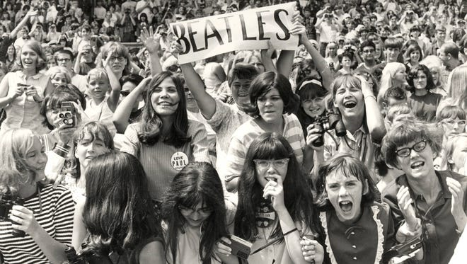 Beatles fans scream and shout for the Fab Four at the concert at Crosley Field on Aug. 21, 1966.