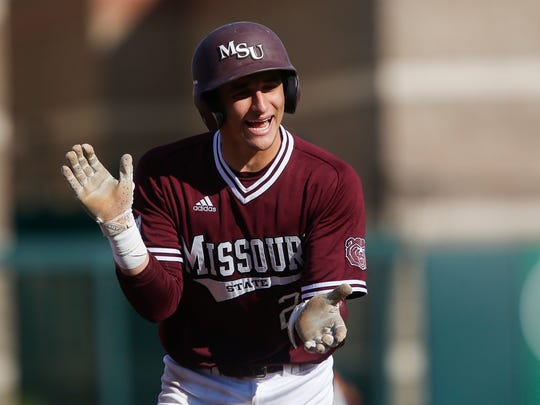 Drew Millas, of Missouri State, claps after Hunter Steinmetz's home run as the Bears took on Oklahoma State in their 2018 home opener at Hammons Field on Wednesday, March 7, 2018.