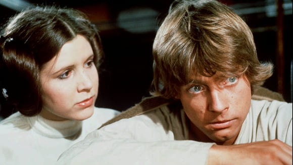 Luke Skywalker (Mark Hamill), right, is comforted by Princess Leia (Carrie Fisher) in 'Star Wars.'