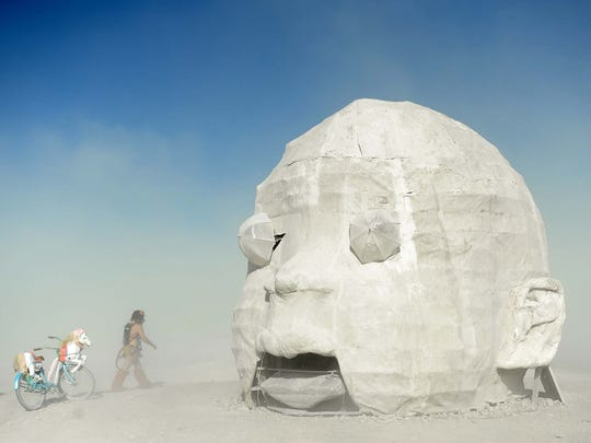 """Sam Ray visits the """"Baby Head"""" art piece on the playa"""