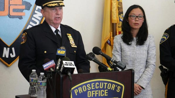 Linden police chief James M. Schulhafer speaks about drug related arrests, Tuesday, April 22, 2014, during a press conference at the Union County Prosecutor's Office in Elizabeth. At right is Acting Union County Prosecutor Grace H. Park.