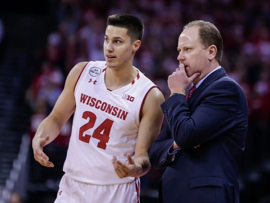 Wisconsin coach Greg Gard, right, talks with Bronson Koenig during the second half of an NCAA college basketball game against Minnesota, Sunday, March 5, 2017, in Madison, Wis. (AP Photo/Andy Manis)