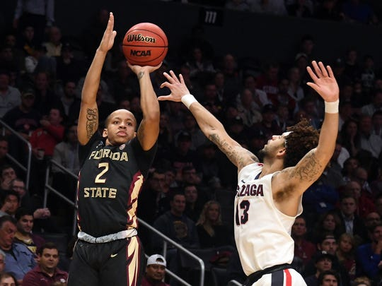 Florida State Seminoles guard CJ Walker (2) shoots against Gonzaga Bulldogs guard Josh Perkins (13) in the first half in the semifinals of the West regional of the 2018 NCAA Tournament at STAPLES Center.