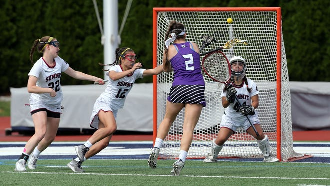 Girls lacrosse NJSIAA Tournament of Champions semifinal game between Rumson-Fair Haven and Summit  held at Monmouth University in West Long Branch on Wednesday June 8, 2016.
