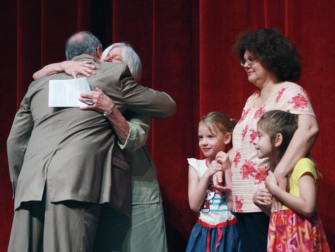 Marshall Public Schools Superintendent, Dr. Randy Davis gave Scott Blankinship's family hugs as they accepted The Superintendent's Award in his honor during the Annual Community Breakfast at Marshall HIgh School Monday morning. Stephanie Parshall/For The Enquirer