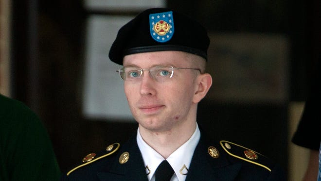 Army Pfc. Bradley Manning is escorted out of a courthouse in Fort Meade, Md.,  on July 2.