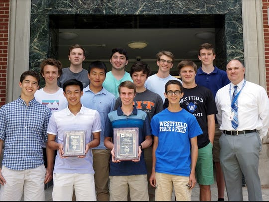 Recipients of the award are Westfield High School's (top row from left) Aidan Paul, Ben Halevy, Jack Liebling, and Jack Schwartz; (middle row from left) Cole Feltman, Kevin Tsui, Jacob Davis and Matt Stravach, with Jim DeSarno, assistant principal at Westfield High School; and (bottom row from left) Patrick Chirichella, Chris Ng, Mark Kostyack and  Eli Burk. The plaque presented to the students will remain on display at Westfield High School.