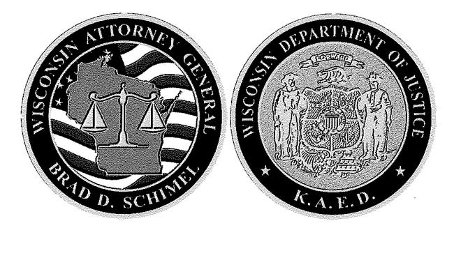 Attorney General Brad Schimel's office spent near nearly $10,000 for medallions with KAED, short for his new motto, Kicking Ass Every Day.