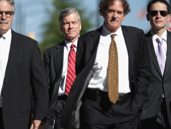 RICHMOND, VA - AUGUST 26:  Former Virginia Governor Bob McDonnell (2nd L) walks with his legal team before entering the U.S. District Court for the Eastern District of Virginia August 26, 2014 in Richmond, Virginia. McDonnell and his wife Maureen are on trial for accepting gifts, vacations and loans from a Virginia businessman in exchange for helping his company, Star Scientific.  (Photo by Chip Somodevilla/Getty Images)