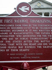 The repainted First National Thanksgiving sign, in front of the York County Administrative Center, notes how the first Thanksgiving was proclaimed in York by the Continental Congress Nov. 1, 1777.