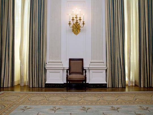 The State Dining room of the White House has been refurbished with new arm chairs, side chairs, and draperies suspended from carved and gilded poles, all of which were selected with the approval of the Committee for the Preservation of the White House in consultation with first lady Michelle Obama, as seen Tuesday, July 7, 2015 in Washington. (AP Photo/Jacquelyn Martin)