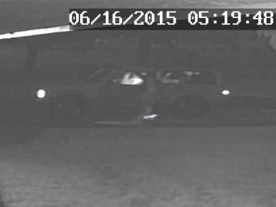 A 2015 screenshot from a Gassville resident's surveillance video shows a person breaking into his Jeep on Sunshine Avenue.