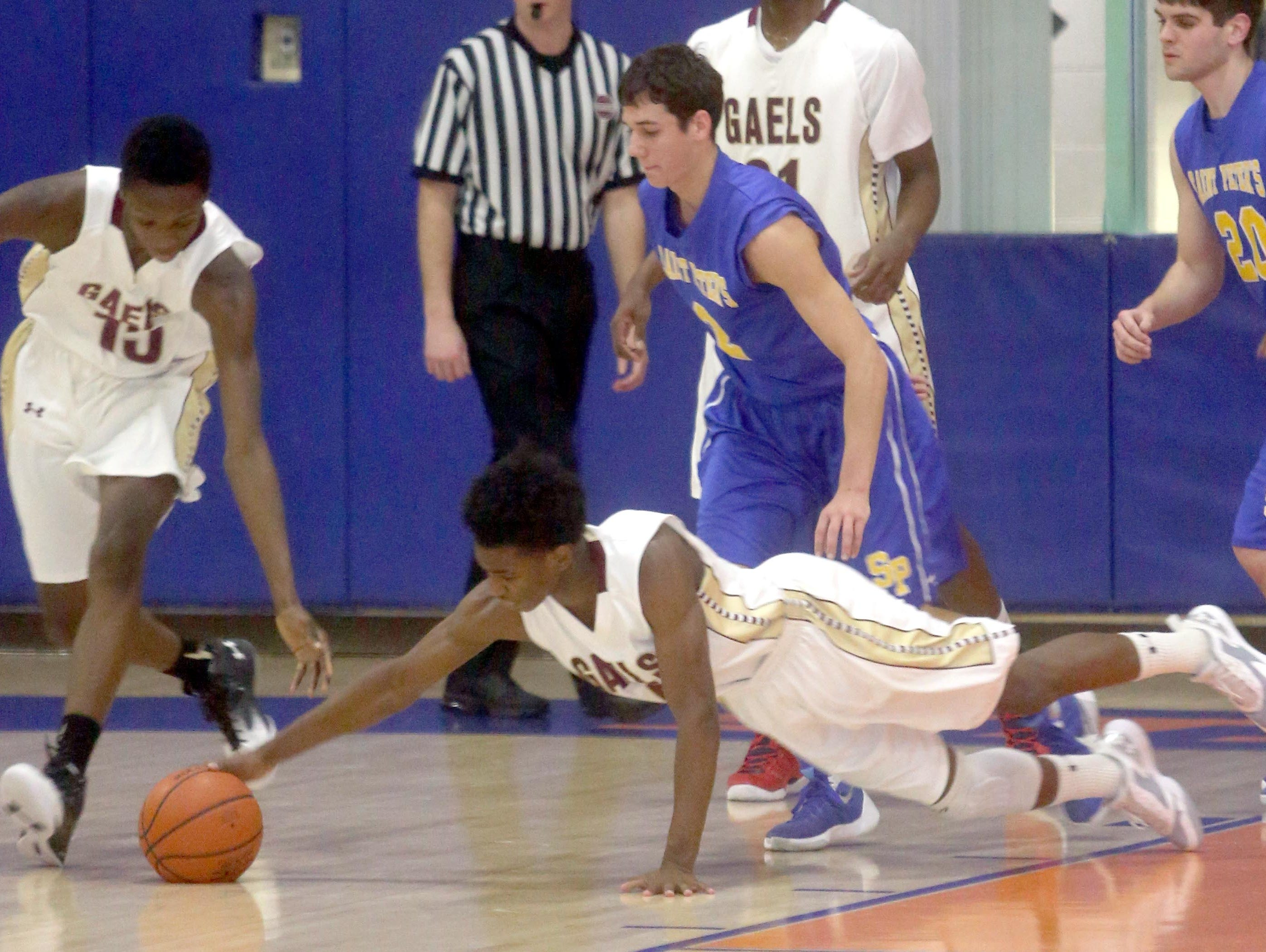 Iona Prep's Gio Gabbidon dives for a loose ball during a CHSAA second round AA playoff basketball game against St. Peter's at St. Raymond High School in the Bronx March 3, 2016. Iona Prep defeated St. Peter's 51-43.