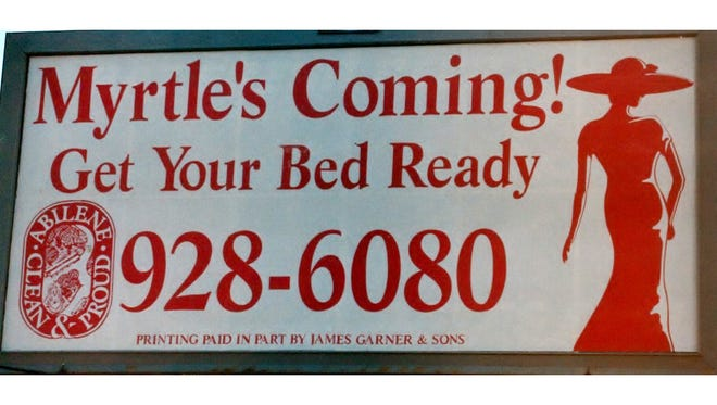 "The infamous ""Myrtle's Coming"" billboard that began the great crape myrtle flap of 1997."