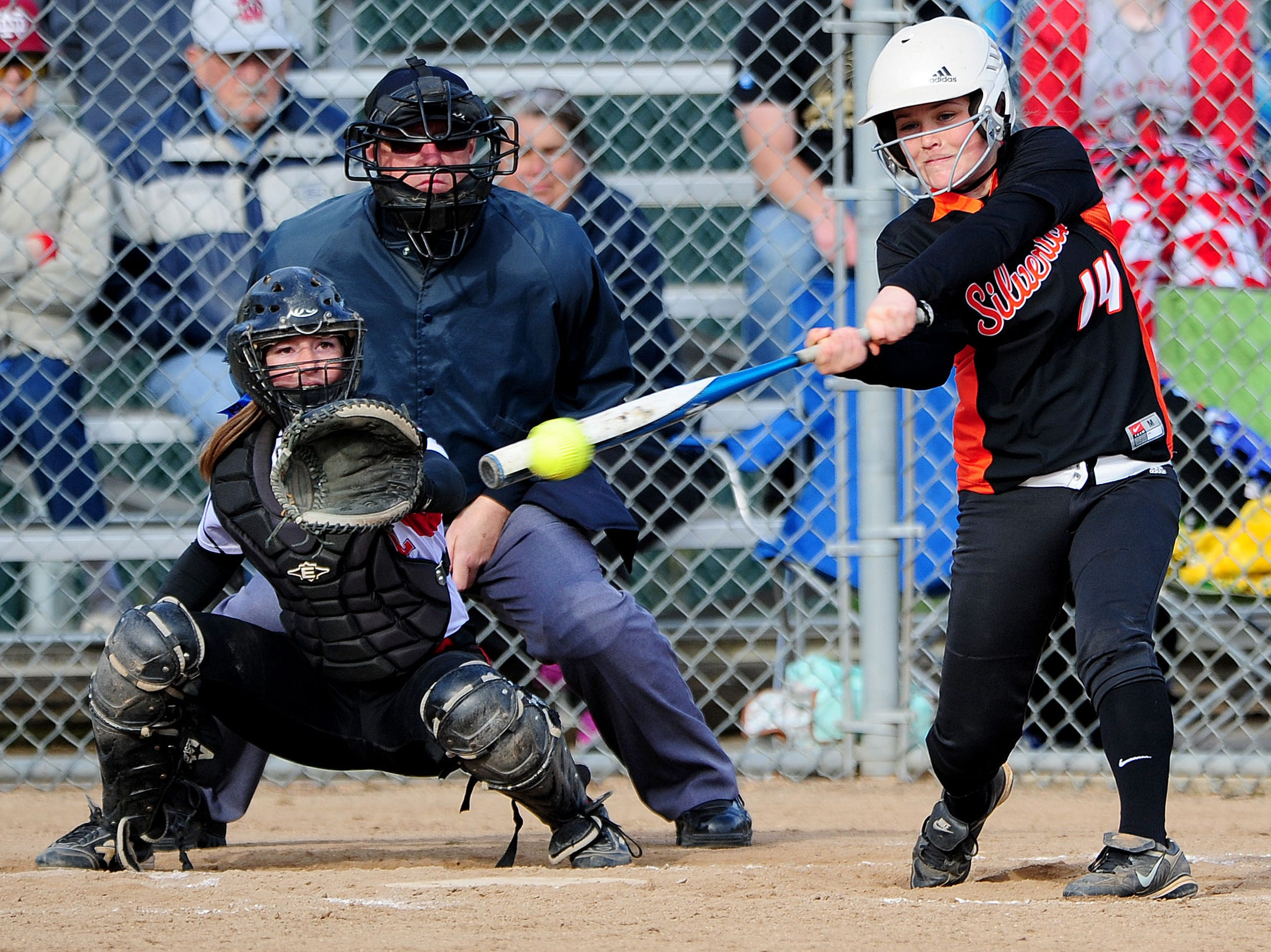 Silverton batter Megan Mannion knocks in an RBI in the seventh inning against Central during the first game of a doubleheader, on Friday, April 24, 2015, in Independence.