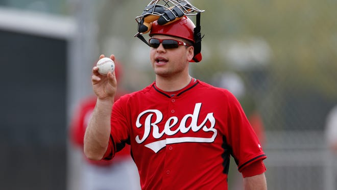 Reds catcher Devin Mesoraco directs the infield during practice in Goodyear on Feb. 25.