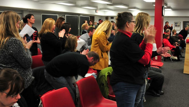 Supporters of Sevastopol Elementary Principal Mary Donaldson applaud a speaker during the School Board meeting Thursday.