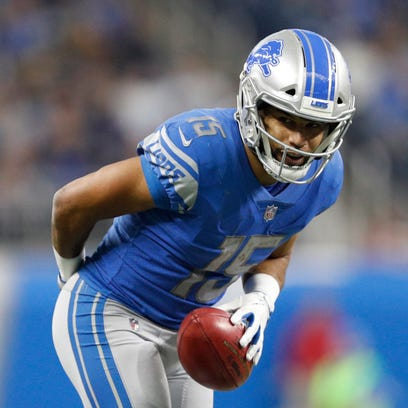 Lions receiver Golden Tate bows after a play during