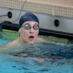 Marshall wins league swim meet for first time at school