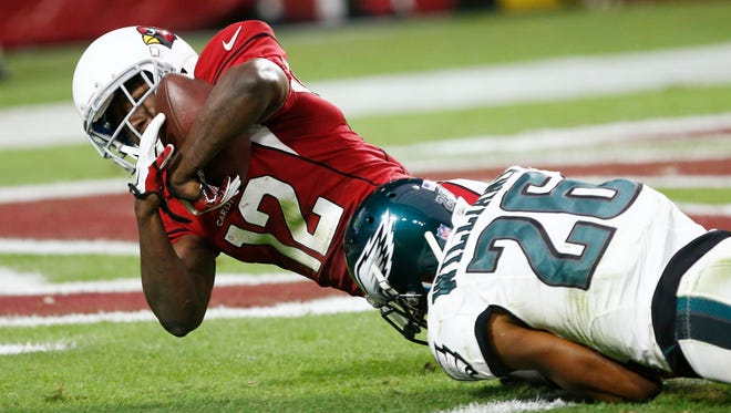 Cardinals receiver John Brown dives into the end zone for the game-winning touchdown on Sunday against the Philadelphia Eagles.