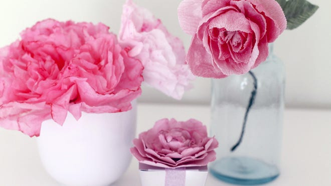 These flowers were fashioned from a variety of different types of paper: coffee filters, cardstock and crepe paper.