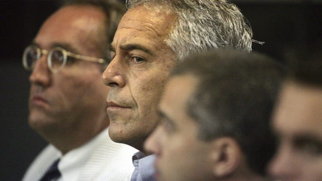 Jeffrey Epstein, center, in Palm Beach County Circuit Court in July 2008, when he pleaded guilty to two counts, including soliciting a minor for prostitution, after federal officials agreed to not prosecute him.