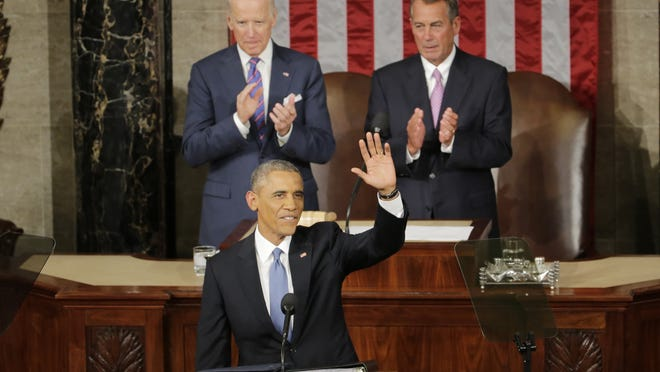 Obama waves before giving his address as Vice President Joe Biden and House Speaker John Boehner applaud.