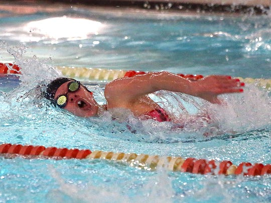 Mansfield Christian's Abby Reynolds swims in the 200-yard freestyle during Saturday's sectional meet at Malabar.