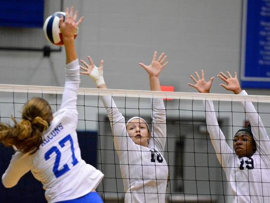 West York's Trilby Kite, center, and Tesia Thomas, right, were named all-state in Class 3-A by the Pennsylvania Volleyball Coaches Association. DISPATCH FILE PHOTO