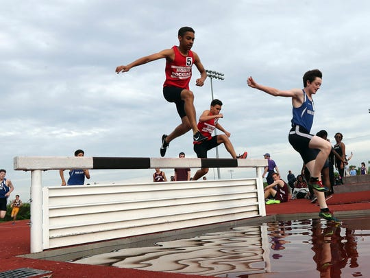 Jack Reynolds of Pearl River, right, won the steeplechase event during Rockland County track & field championships at Clarkstown South High School May 17, 2018. Daniel Shephard of North Rockland finished in second place.