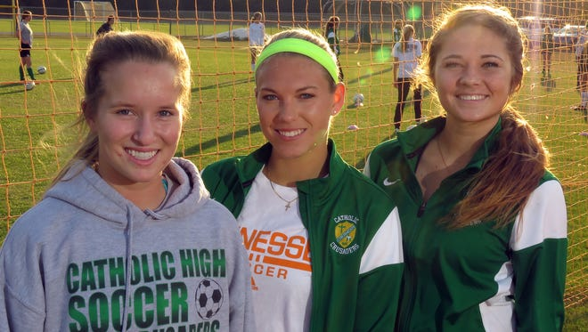 Pensacola Catholic High girls soccer players (l-r) Audrey Presnell, Gretchen Cagle and Tayler Kukes.