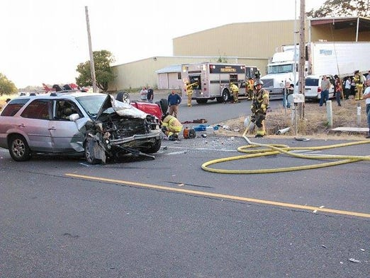 Four people were injured in a three-vehicle crash on Highway 99E near Brooks, Aug. 1, 2014.