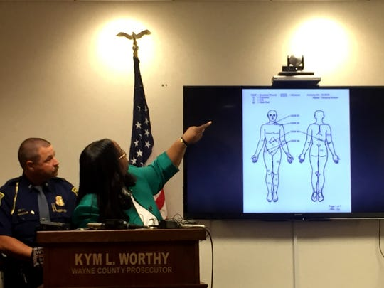 Wayne County Prosecutor Kym Worthy goes over evidence at a news conference in the Terrance Kellom case, the man who was fatally shot by an ICE agent in Detroit on Wednesday, Aug. 19, 2015.