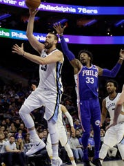Memphis Grizzlies' Marc Gasol shoots in front of Philadelphia 76ers' Robert Covington during the first half of an NBA basketball game Wednesday, March 21, 2018, in Philadelphia. (AP Photo/Matt Slocum)