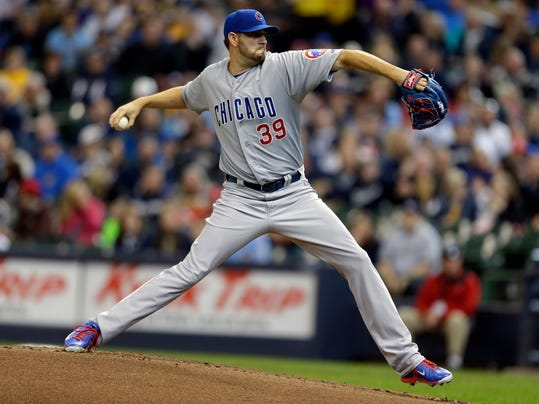 Chicago Cubs starting pitcher Jason Hammel throws to the Milwaukee Brewers during the first inning of a baseball game on Sunday, April 27, 2014, in Milwaukee. (AP Photo/Jeffrey Phelps)
